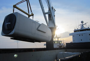 A hartman trader 18 type vessel lifting a nacelle on board of vessel.