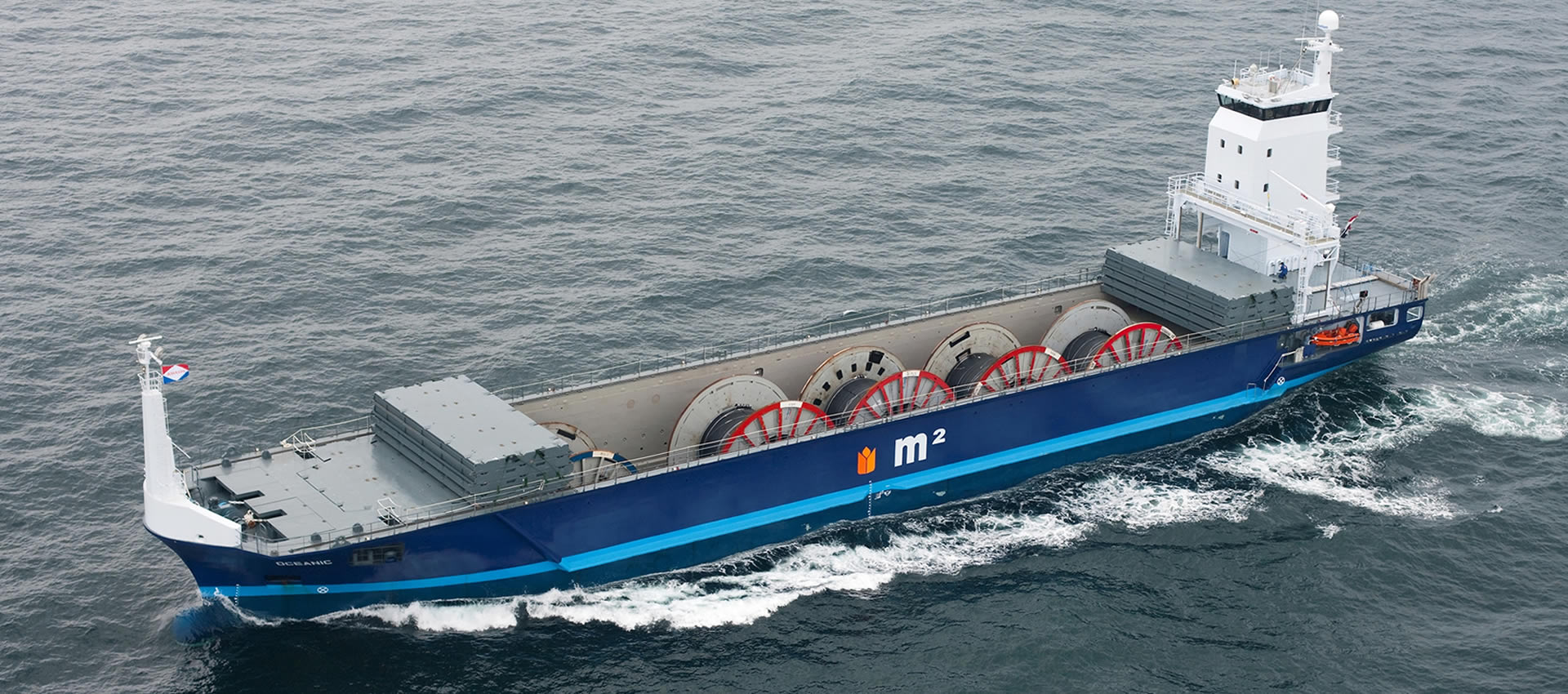 The mv Oceanic sailing open top with cable reels for offshore.