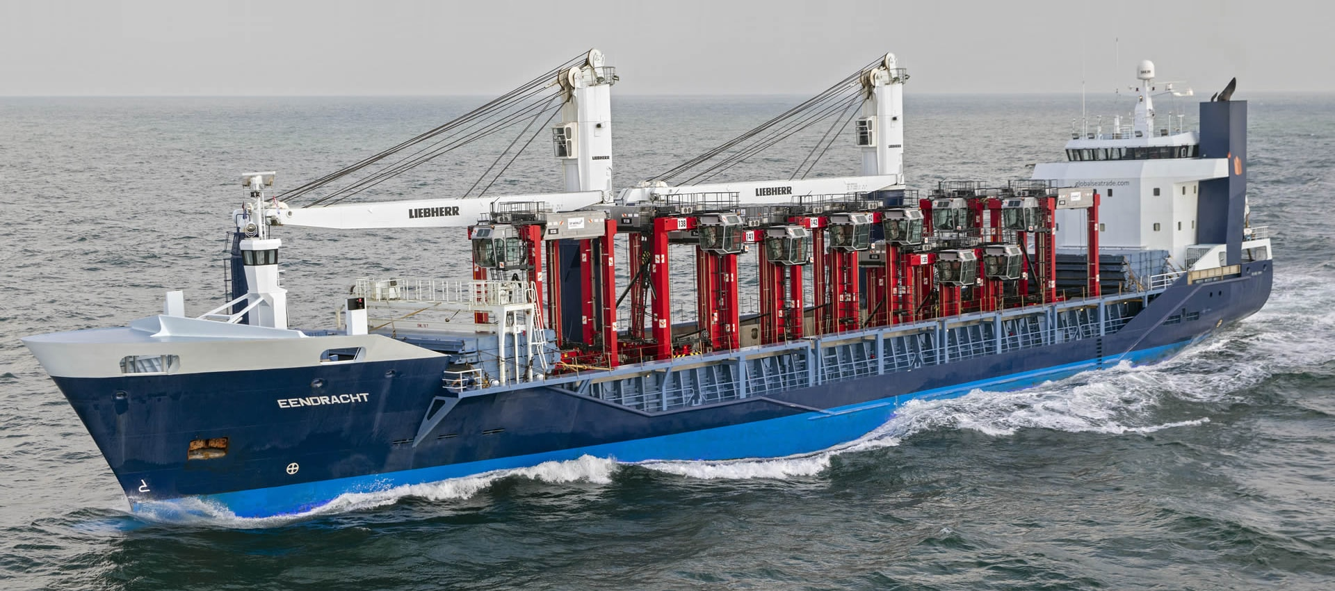 The mv Eendracht sailing open top with load of container stackers.
