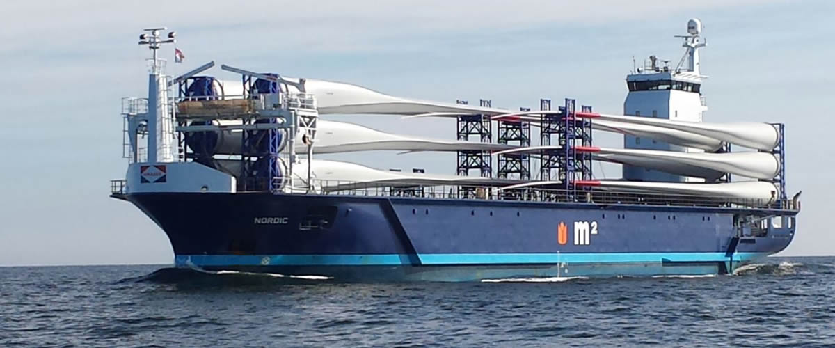 The m2 type vessel Nordic with windmill blades on deck.